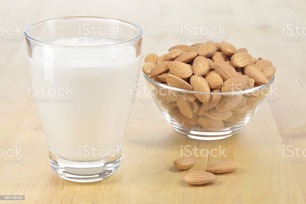 Glass of Almond milk on a table. stock photo