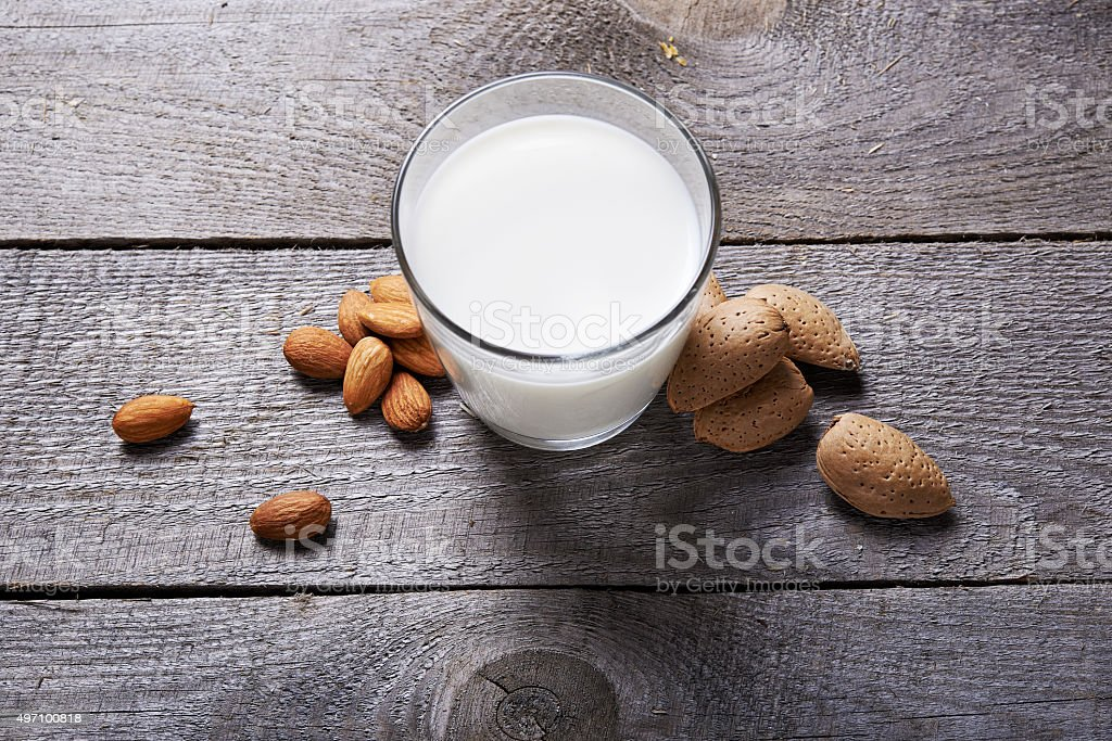 glass of almond milk stock photo