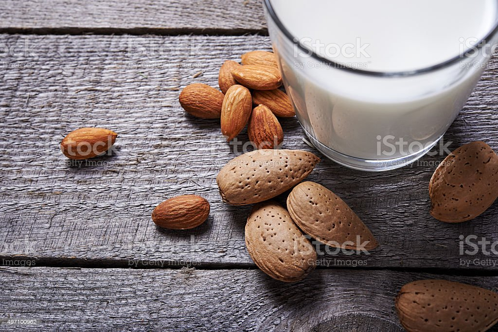 glass of almond milk stock photo