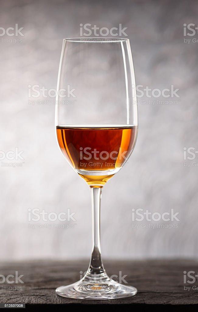 Glass of amontilliado sherry on wooden plank stock photo