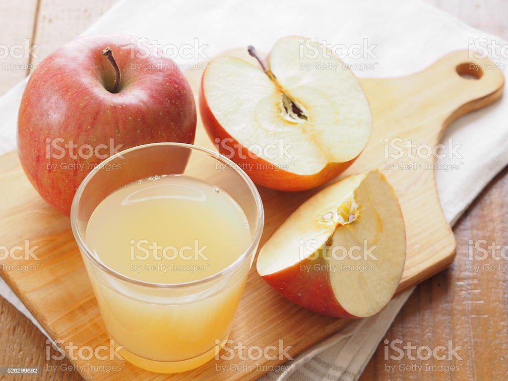 Glass of apple juice and fresh red apple stock photo