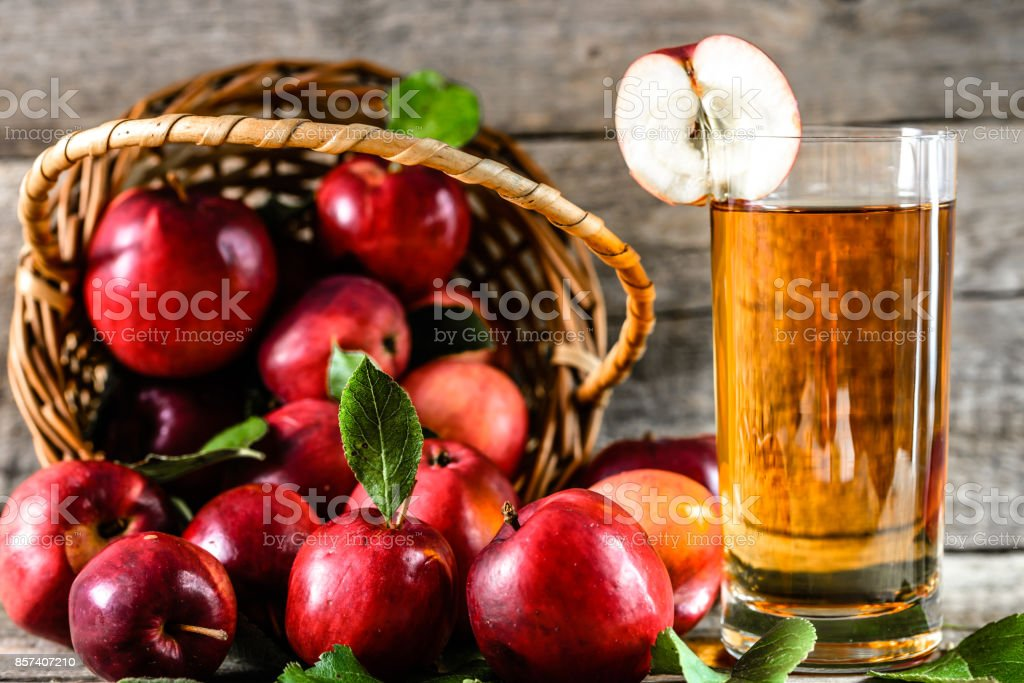 Glass of apple juice and sweet apples on wooden table, organic food and well being concept stock photo