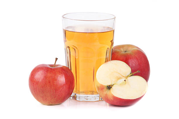 Glass of apple juice Apple juice on white background hot apple cider stock pictures, royalty-free photos & images