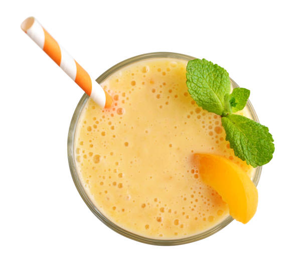 Glass of apricot milkshake stock photo