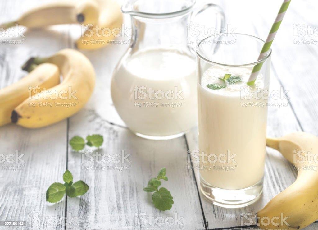 Glass of banana milk shake stock photo