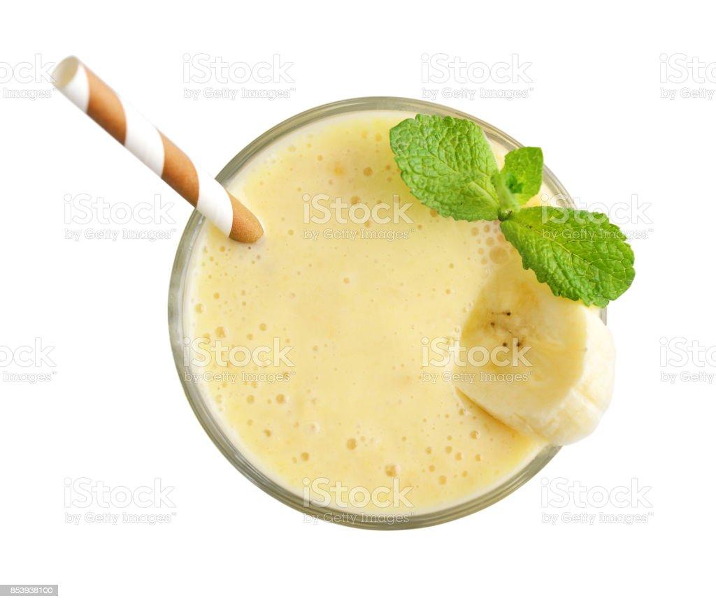 Glass of banana milkshake stock photo