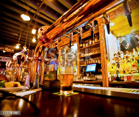 istock Glass of beer and beer taps in a bar 177781861