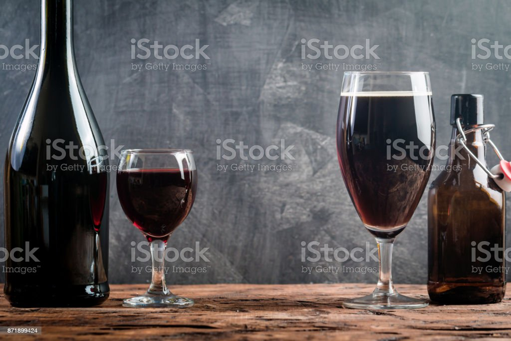Glass of Beer and red wine stock photo