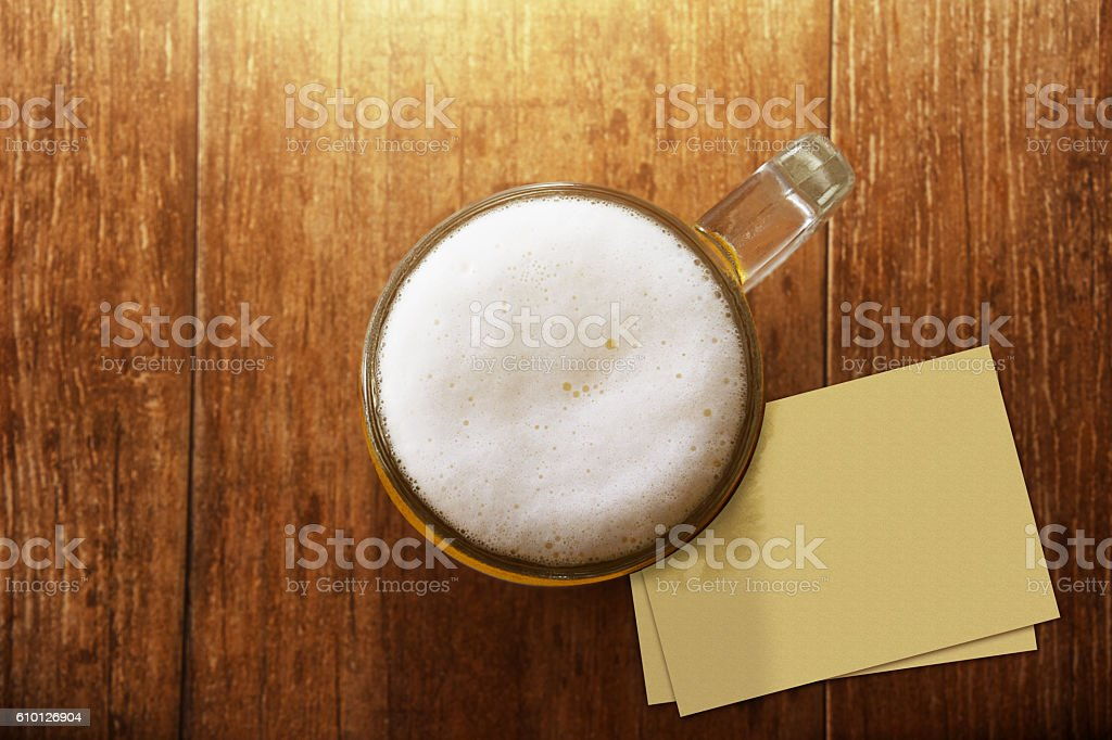 Glass of Beer at Bar with Blank Paper Note stock photo