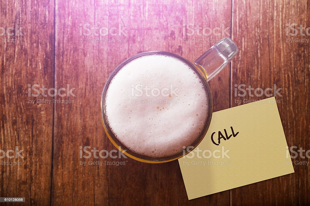 Glass of Beer at Bar with Note : Call stock photo