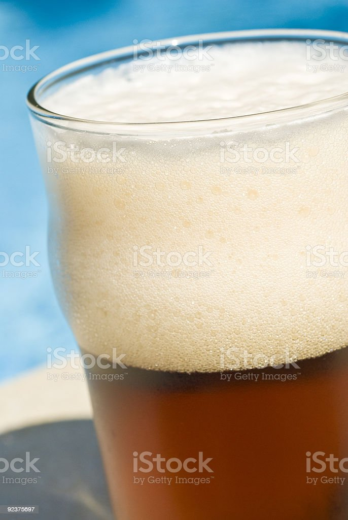 Glass of Beer by the Swimming Pool royalty-free stock photo