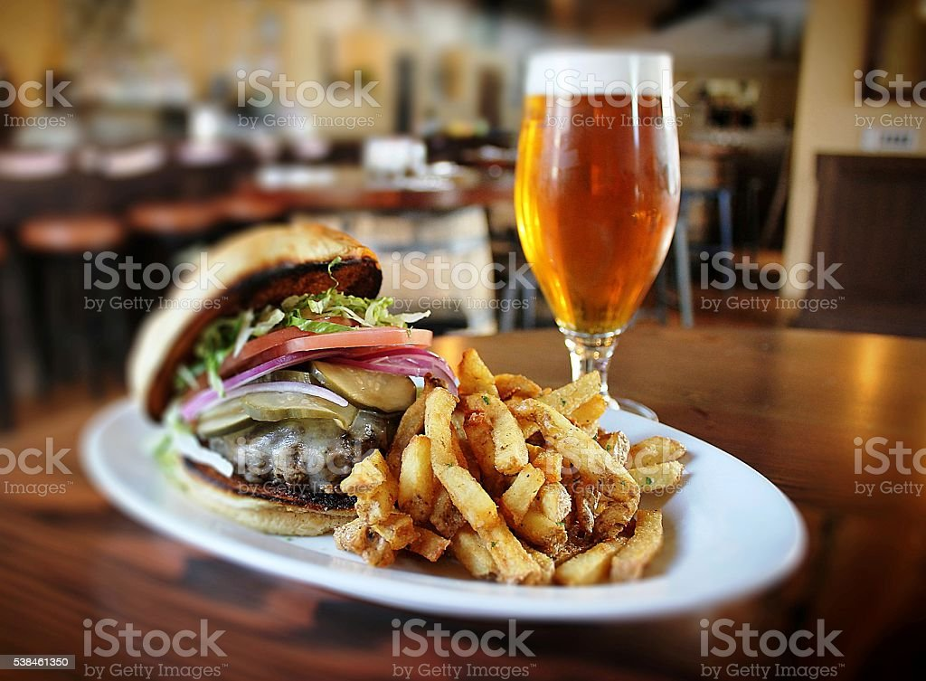 Glass of beer , french fries and hamburger stock photo