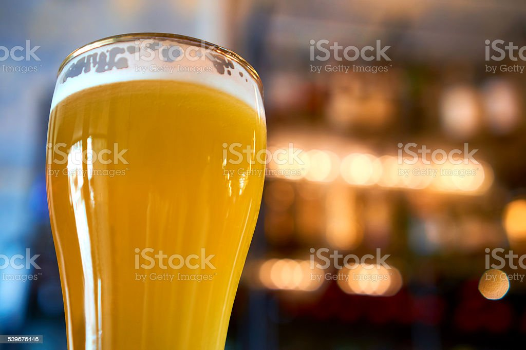 glass of beer in pub stock photo