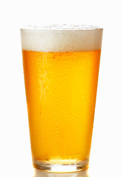 glass of beer isolated - beer glass stock photos and pictures