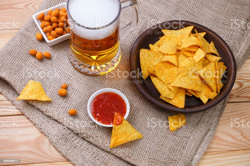 Glass of beer. Nachos chips. Tortilla snack. royalty-free stock photo