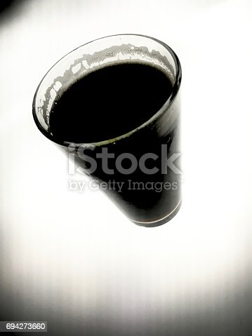 istock Glass Of Beer On An Illuminated Table 694273660