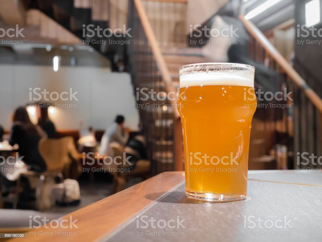 Glass of beer on counter bar stock photo