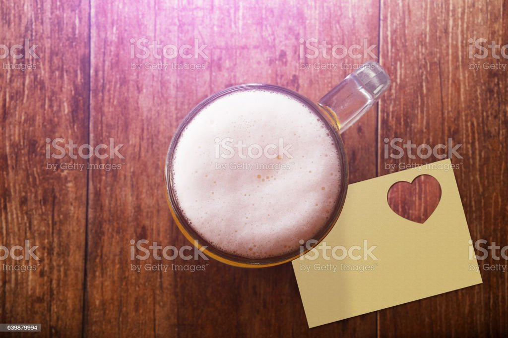 Glass of Beer on the Wooden Table at Bar stock photo