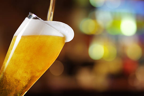 Glass of beer Inclined Glass of beer  beer glass stock pictures, royalty-free photos & images