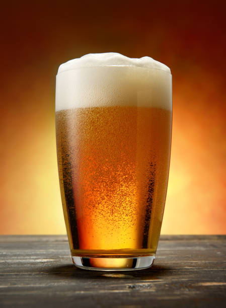 Glass of beer Glass of lager on a wooden table lager stock pictures, royalty-free photos & images