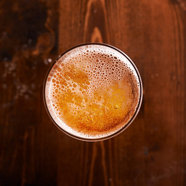 glass of beer shot top down glass of beer shot top down on wooden table overhead projector stock pictures, royalty-free photos & images