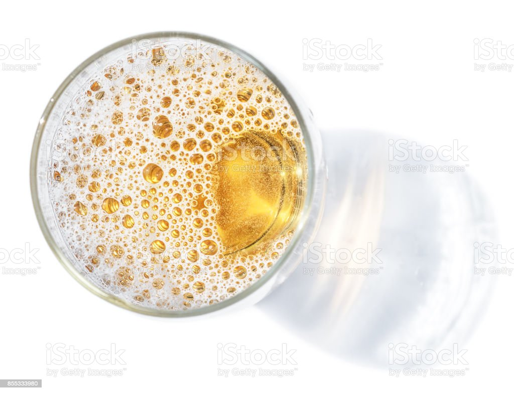 Glass of beer. Top view of lager beer or light beer on the white background. stock photo