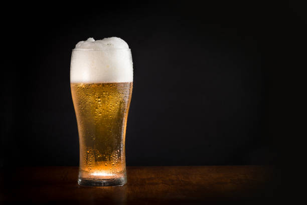 Glass of beer with black background Glass of fresh cold chilled beer with black background beer glass stock pictures, royalty-free photos & images