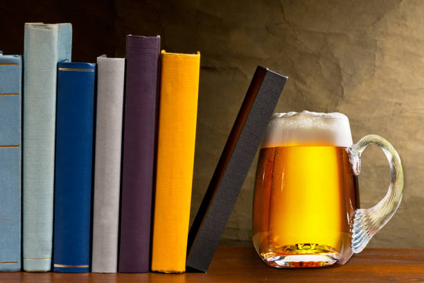 Glass of beer with books in the library stock photo