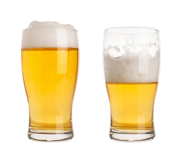 glass of beer with clippin path two glasses of beer, one half empty, one full. isolated on white with clipping path pilsner stock pictures, royalty-free photos & images