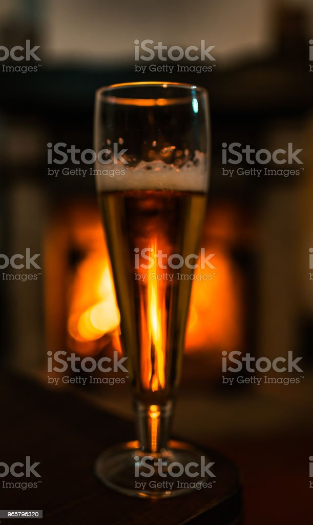 Glass of beer with fireplace - Royalty-free Alcohol Stock Photo