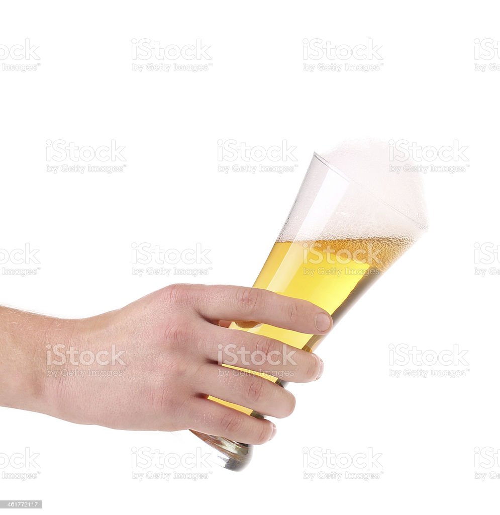 Glass of beer with foam in hand. stock photo