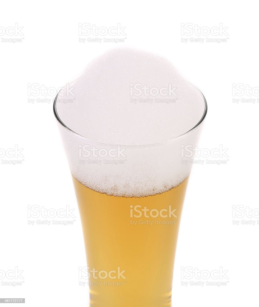 Glass of beer with foam. stock photo