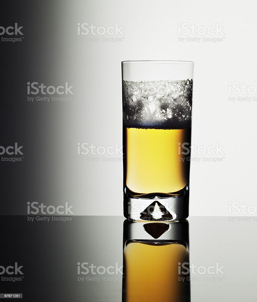 Glass of beer with foam royalty-free stock photo