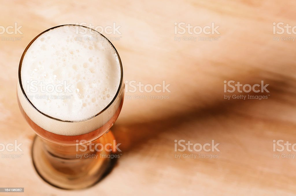 Glass of beer with long shadow royalty-free stock photo