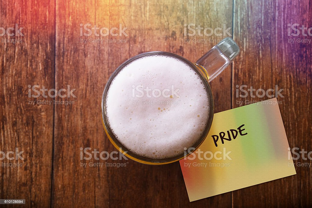 Glass of Beerat Bar with Rainbow light, Note : Pride stock photo