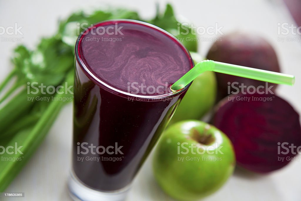 Glass of beet juice with apples and celery royalty-free stock photo