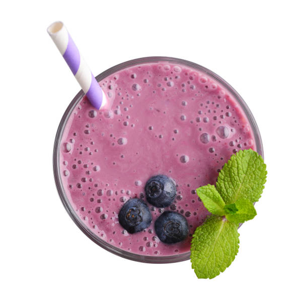 Glass of blueberry milkshake stock photo