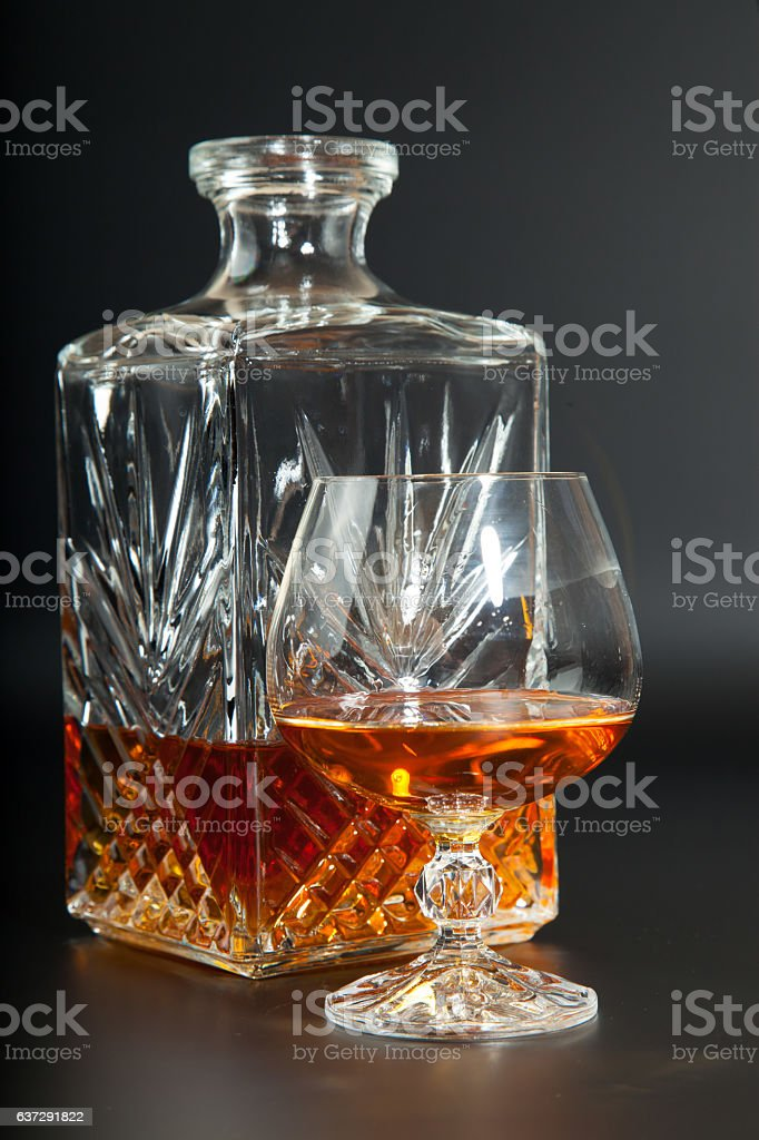 Glass of brandy and a carafe stock photo