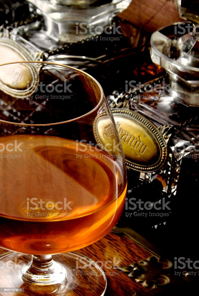 Glass of brandy on the table stock photo