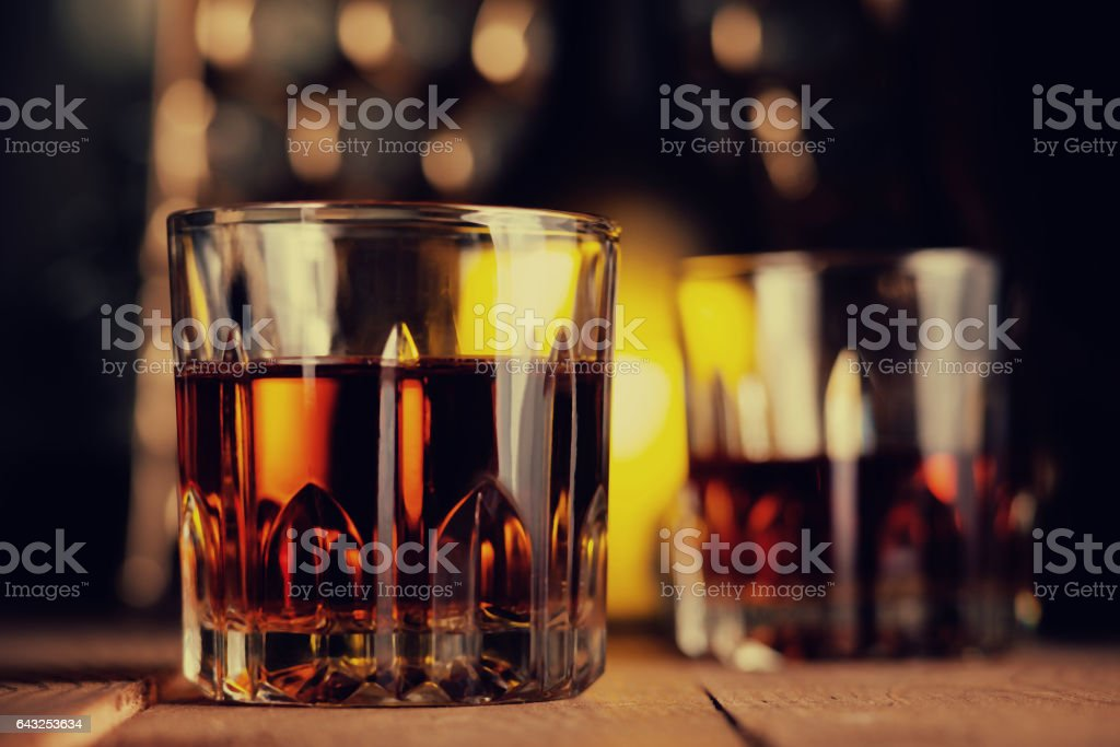 Glass of brandy on the wooden table stock photo
