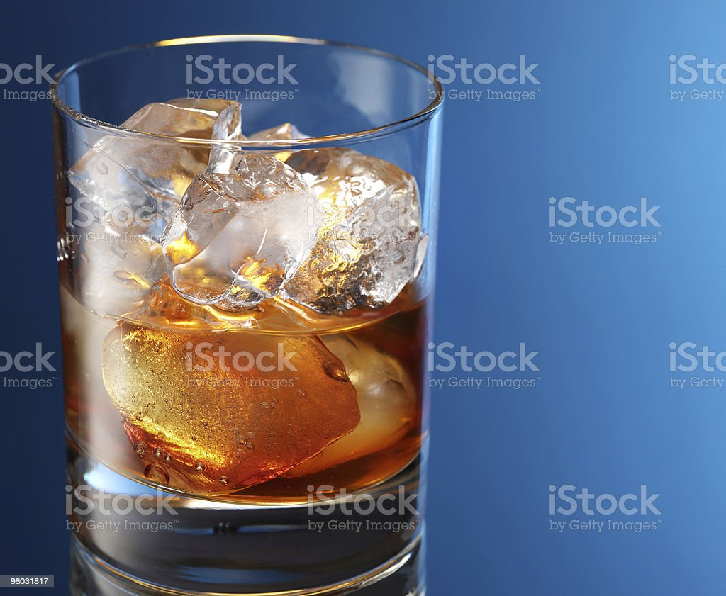 Glass of brandy with ice cubes royalty-free stock photo