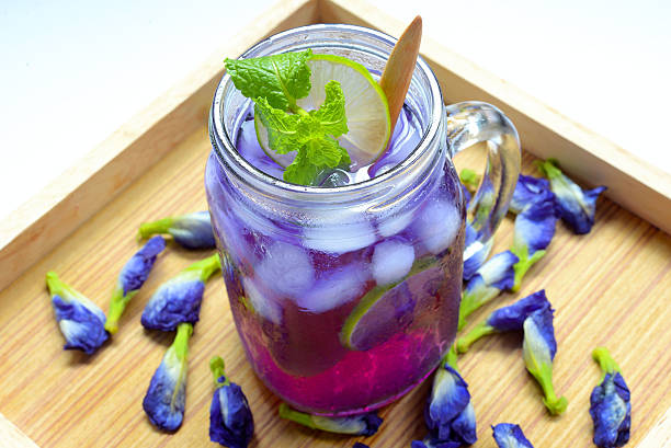 Glass of butterfly pea flower juice - herb drink stock photo