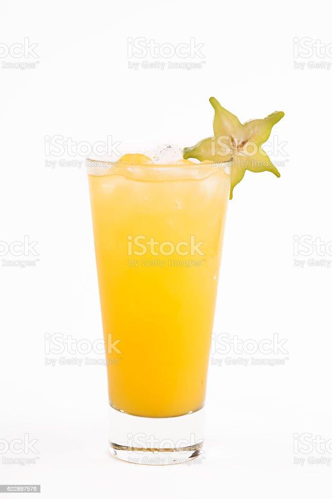 Glass of carambola juice stock photo