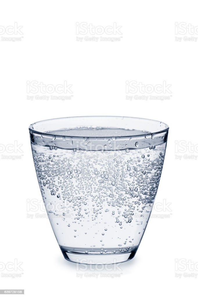 Glass of carbonated water with bubbles on white - Photo