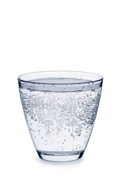 Glass of carbonated water with bubbles on white - foto de stock