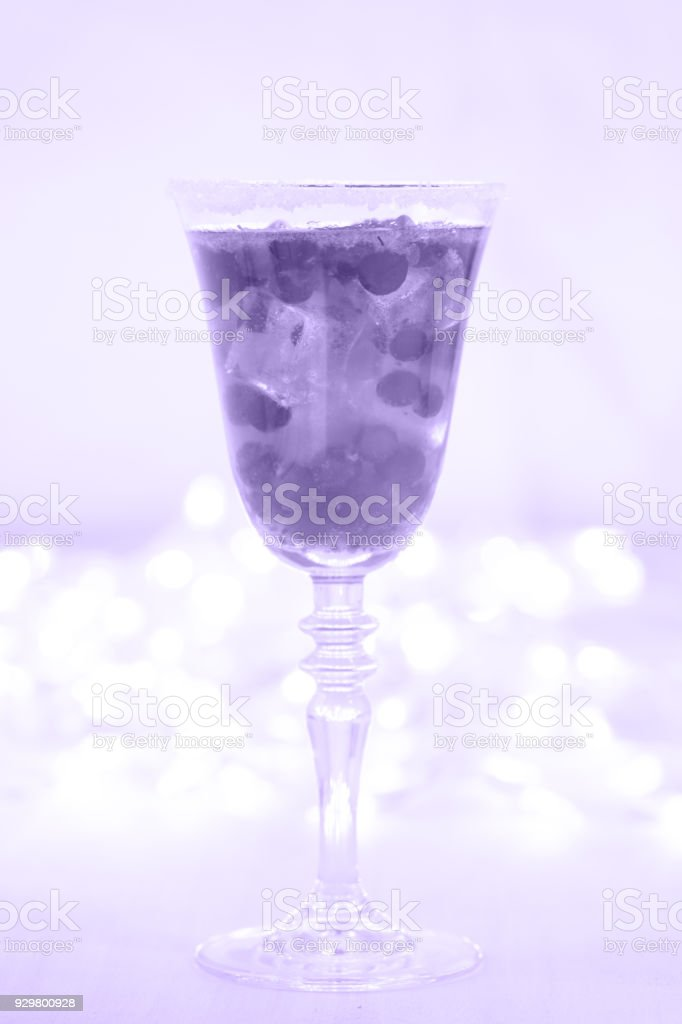 Glass of champagne and cranberry cocktail. Close up. Ultra violet tone, color of the year 2018 stock photo