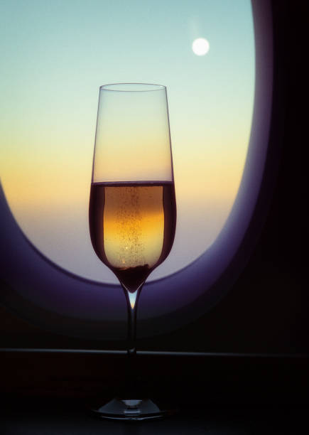 Glass of Champagne and Full Moon on Flight stock photo
