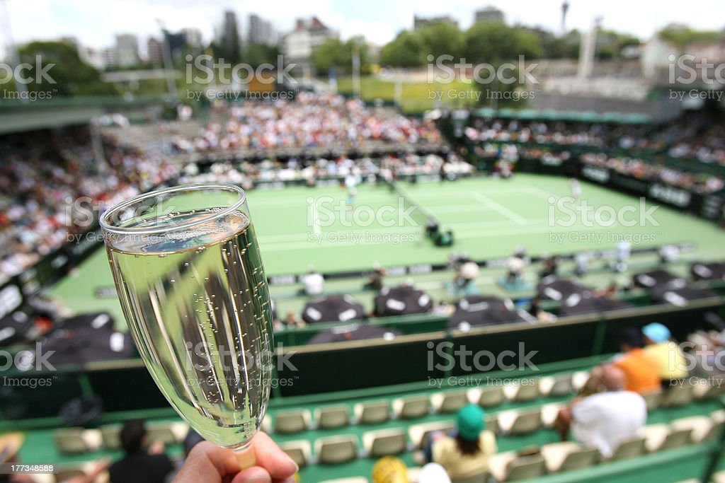 Glass of champagne flute at tennis tournament stock photo
