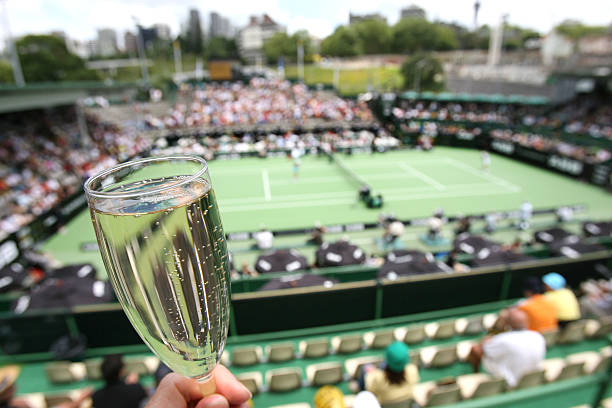 glass of champagne flute at tennis tournament - sports event stock photos and pictures