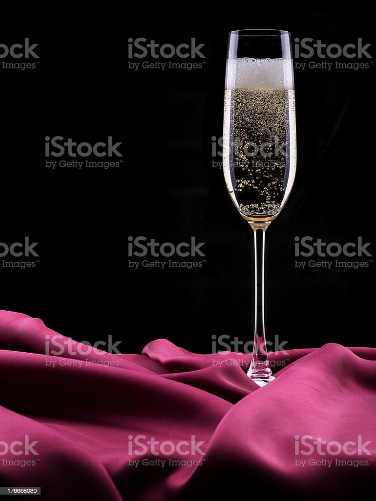 glass of champagne isolated on black background royalty-free stock photo
